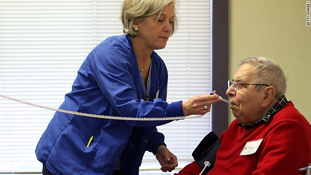 An elderly man gets medical care at a health care center in Novato, California.