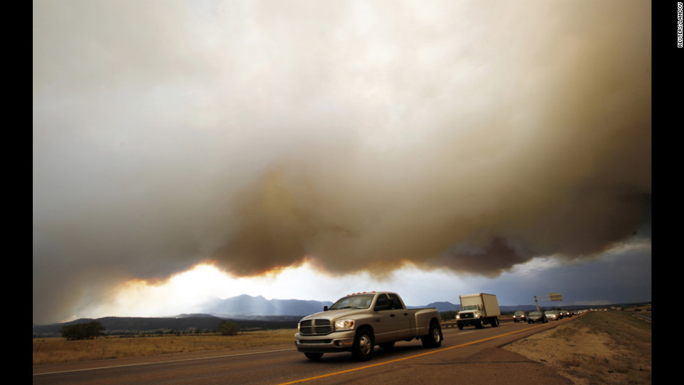 Evacuees drive under a shroud of smoke from the Waldo Canyon Fire on Tuesday.