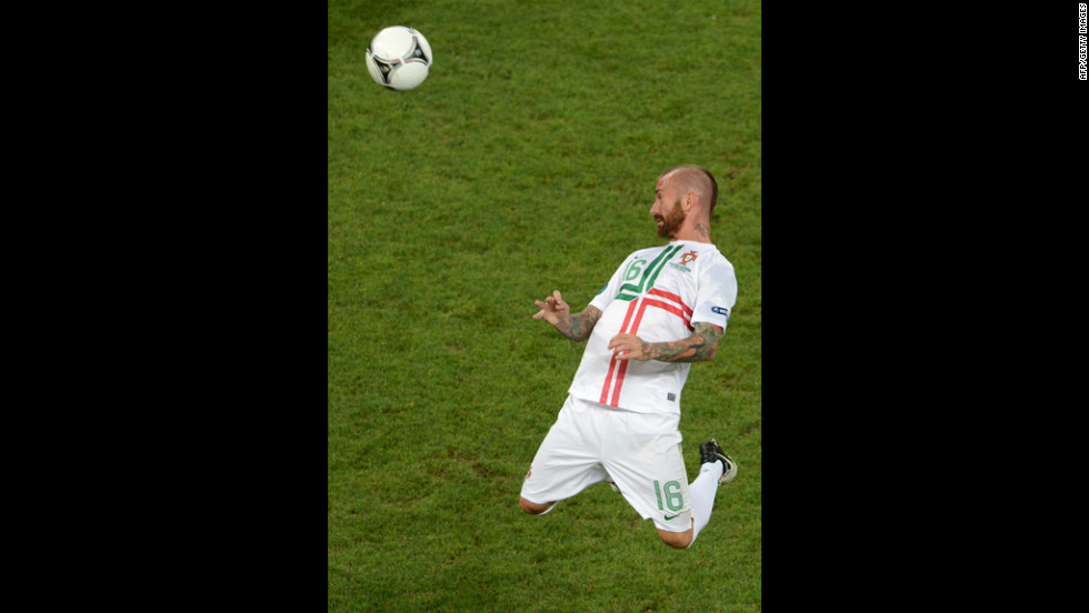 Portuguese midfielder Raul Meireles heads the ball.