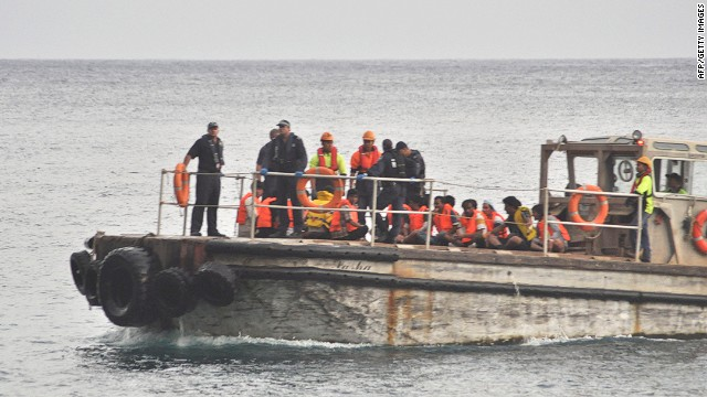 A barge carrying rescued suspected asylum seekers nears Christmas Island on June 22, 2012.