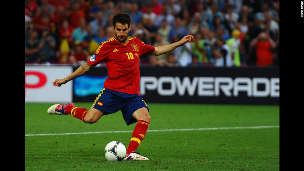 Cesc Fabregas of Spain scores the winning penalty.
