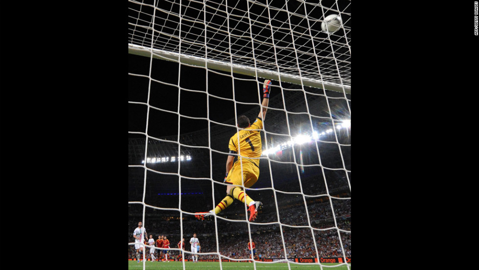 Spanish goalkeeper Iker Casillas jumps for the ball during the semifinal match.