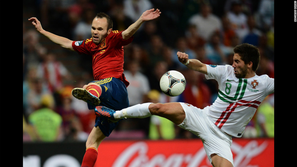 Portuguese midfielder Joao Moutinho, right, vies with Spanish midfielder Andres Iniesta.