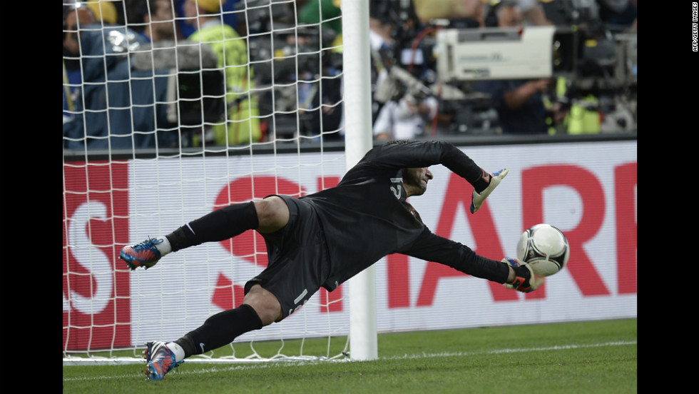 Portuguese goalkeeper Rui Patricio stops a shot during the penalty shootout.