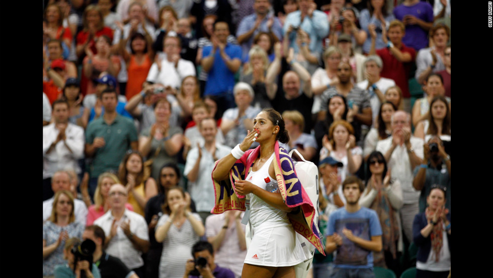 Tamira Paszek of Austria celebrates after beating Caroline Wozniacki of Denmark on Wednesday.