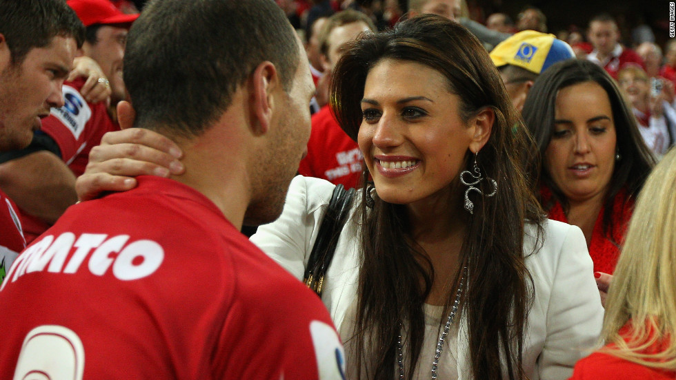 Rice embraces her former boyfriend, rugby star Quade Cooper, after his Queensland Reds won the 2011 Super Rugby Grand Final in July 2011. She was earlier in a relationship with fellow swimmer Eamon Sullivan, but split with both ahead of successive Olympics.
