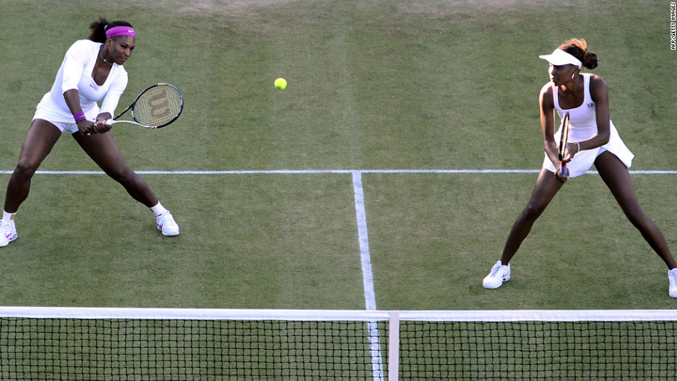 U.S. players Serena Williams, left, and Venus WIlliams in their first-round women's doubles match against Ukraine's Olga Savchuk and Serbia's Vesna Dolonc on June 28.