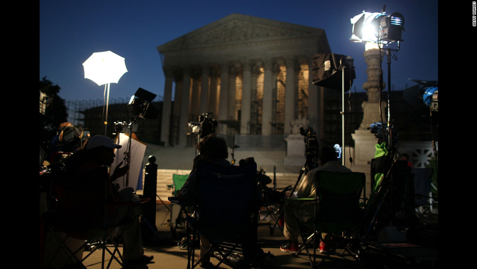 Reporters and camera crews begin waiting early Thursday outside the Supreme Court in anticipation of the court's health care ruling.