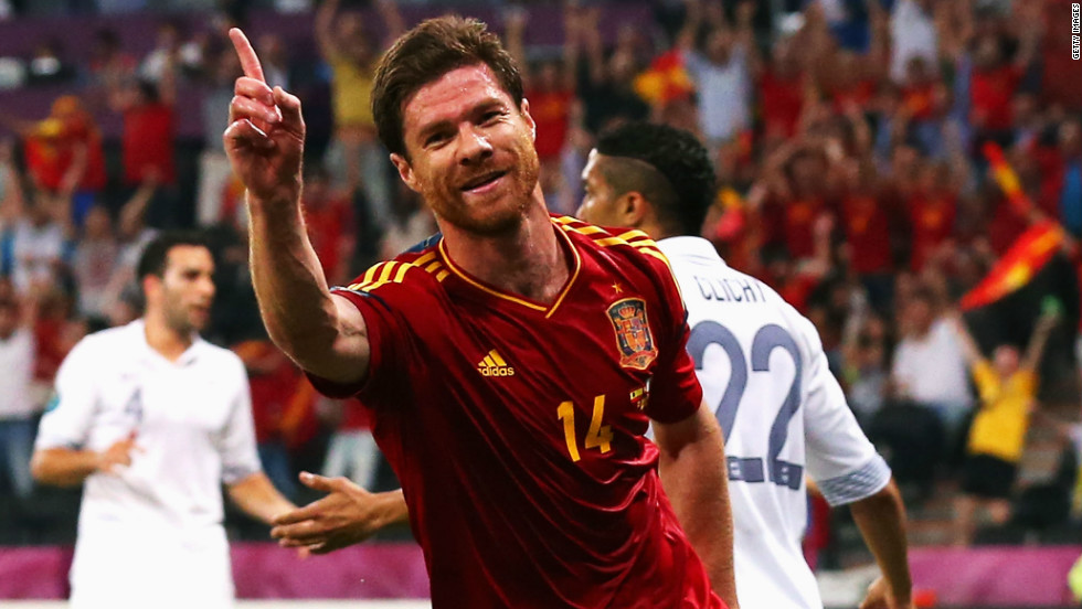 Xabi Alonso scored both of Spain's goals in the quarterfinal against France, leading the champions into a showdown with neighbors Portugal on the occasion of his 100th cap.