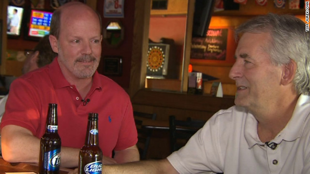Steelworkers Terry Flynn, left, and Steve Bengelsvorf get political at a Dearborn, Michigan, bar.