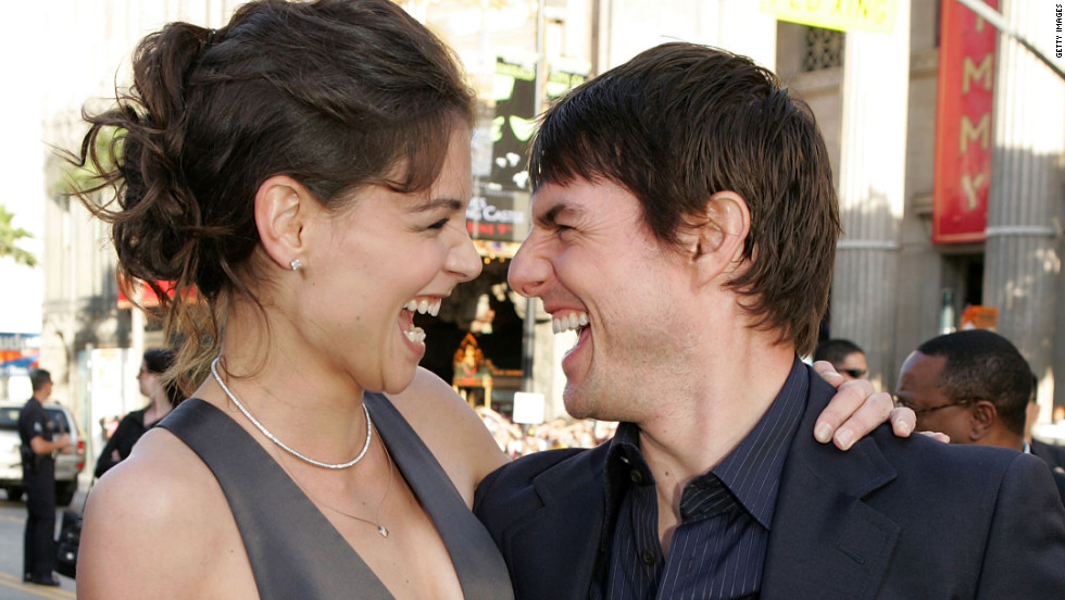 "The couple mug for the cameras at the ""Batman Begins"" premiere in June 2005."