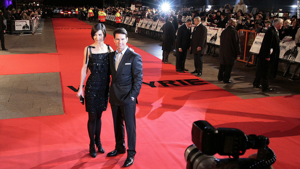 "They pose for photos on the red carpet at the London premiere of his film ""Valkyrie"" in January 2009."