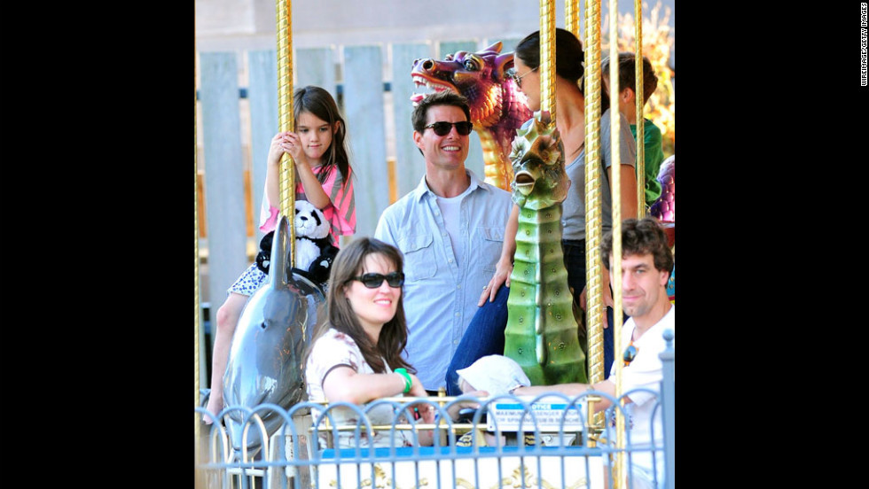 "Cruise and Holmes visit Schenley Plaza's carousel with daughter Suri in October 2011 in Pittsburgh.  Holmes' lawyer released a statement saying, ""This is a personal and private matter for Katie and her family. Katie's primary concern remains, as it always has been, her daughter's best interest."""