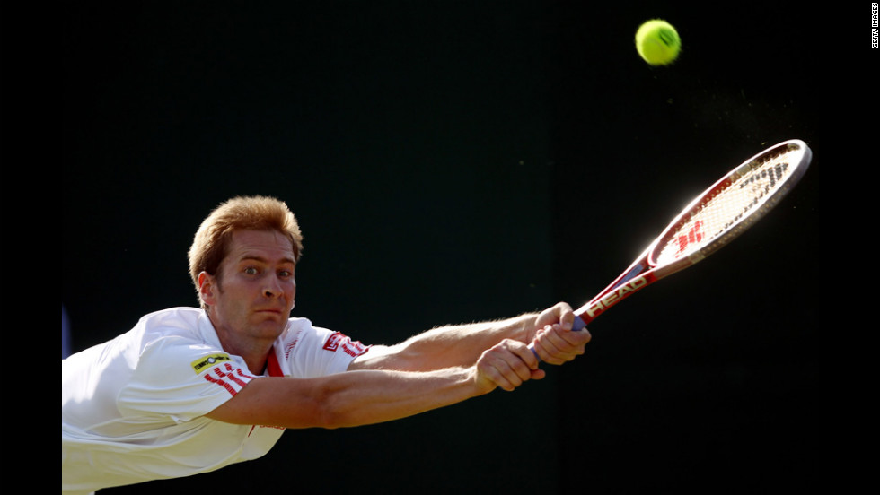 Florian Mayer of Germany hits a backhand return during his third-round match against Jerzy Janowicz of Poland on Friday.