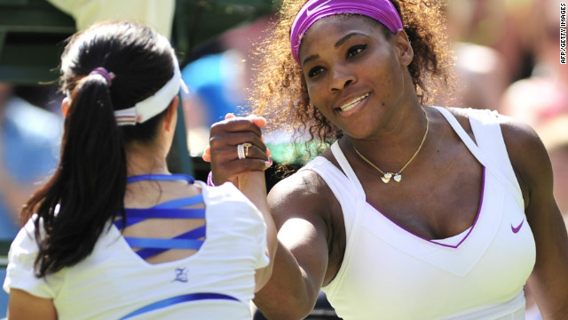 Serena Williams shakes hands with Zheng Jie of China after her three set victory at Wimbledon.