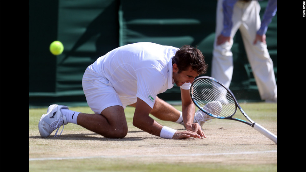 Marin Cilic of Croatia falls to the ground Saturday during play in his match against Sam Querrey of the United States.