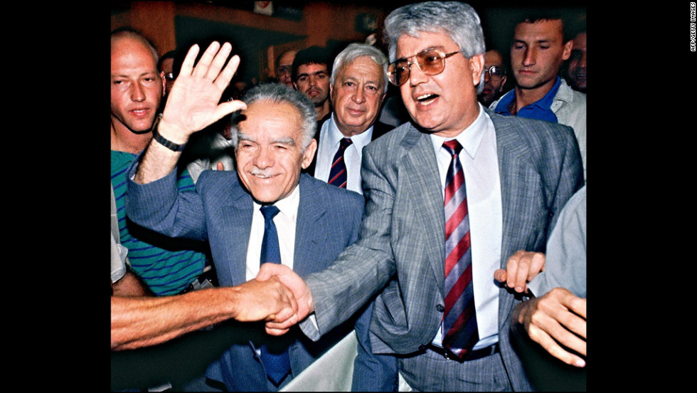 Shamir, left, waves to supporters July 5, 1989, in Tel Aviv as he and his two rivals, Ariel Sharon. center, and David Levy, right, walk in to address the Likud Central Committee. Shamir was military leader of the extremist Stern Gang between 1944 and 1946, and was behind a series of anti-British attacks, before Israel declared its independence in 1948. Shamir had withdrawn from public life over the past decade, silenced by Alzheimer's disease.