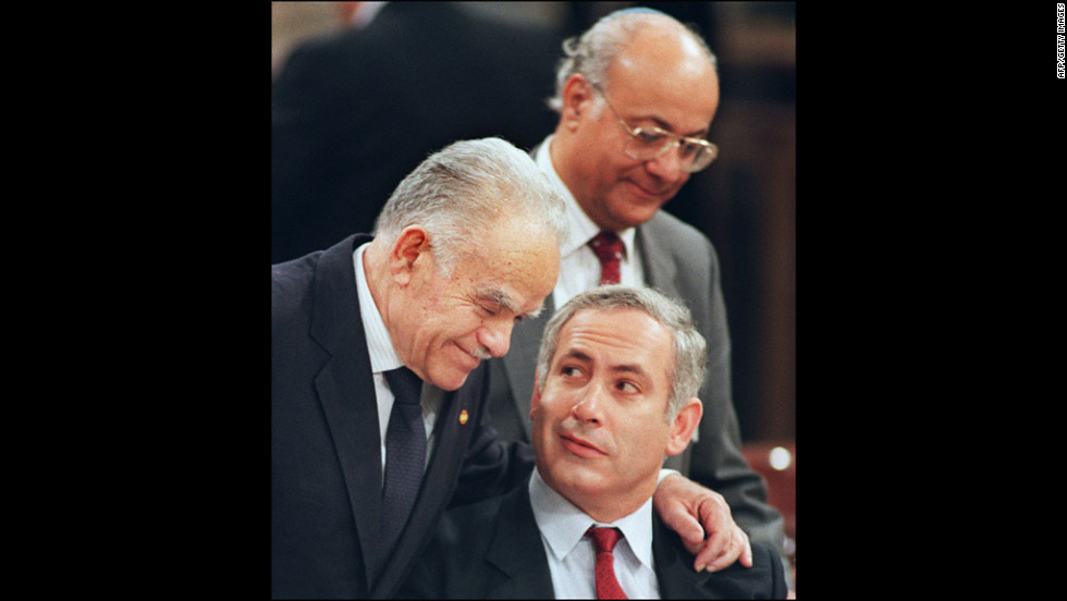 Shamir, left, speaks with adviser Benjamin Netanyahu, right, at the Madrid Middle East Peace conference in Madrid on October 30, 1991. Netanyahu is now in his second tenure as Israel's prime minister.