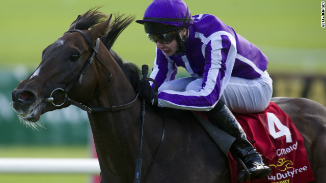 Camelot under jockey Joseph O'Brien powers to victory in the Irish Derby at The Curragh.