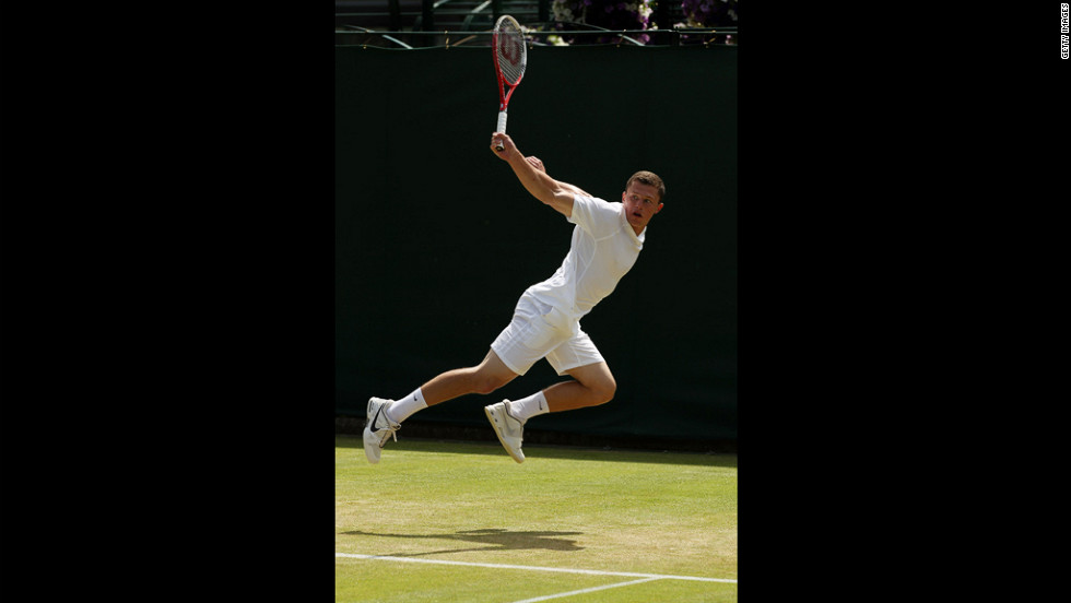 Clay Crawford of Great Britain glides through the air Saturday and returns a backhand to Yoshihito Nishioka of Japan.