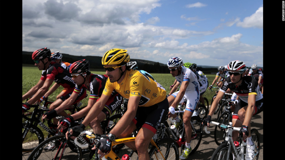 Cancellara, wearing the yellow jersey, rides alongside Cadel Evans of Australia, second from left, and Frank Schleck of Luxembourg, left, on Sunday.