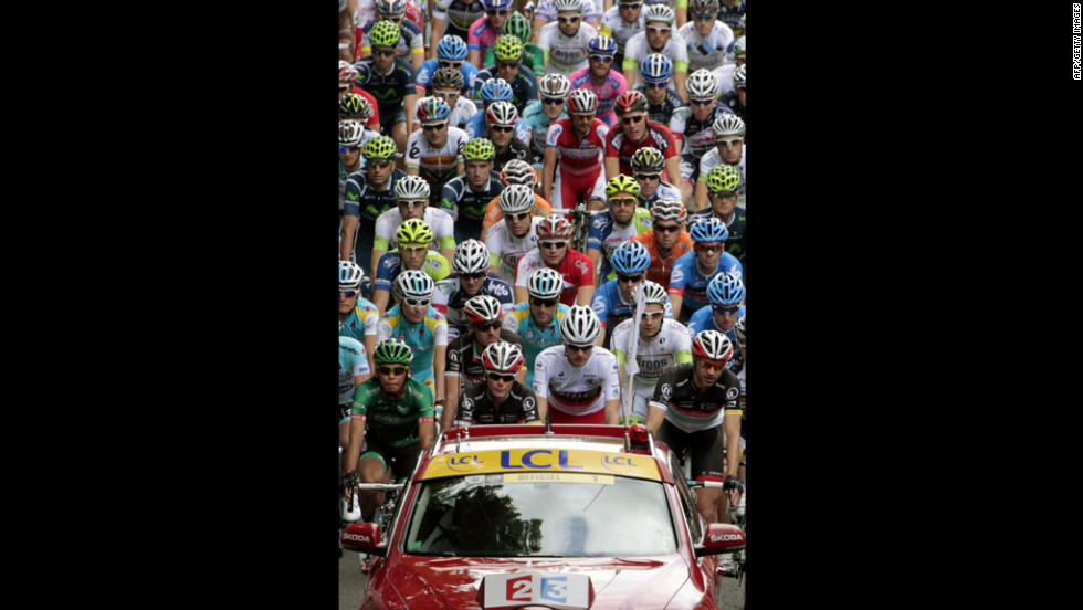 The peloton follows the official Tour de France vehicle at the beginning of Sunday's Stage 1.