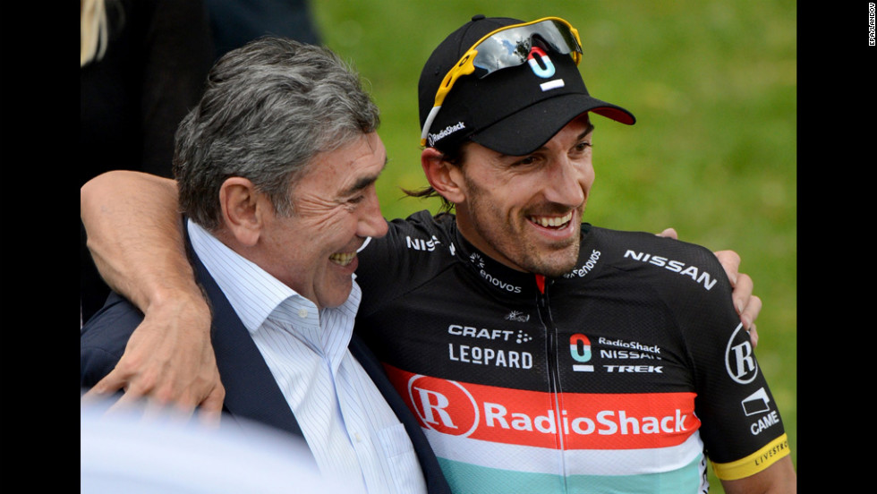 Overall race leader Cancellara embraces former Belgian cyclist Eddy Merckx after Sunday's stage.