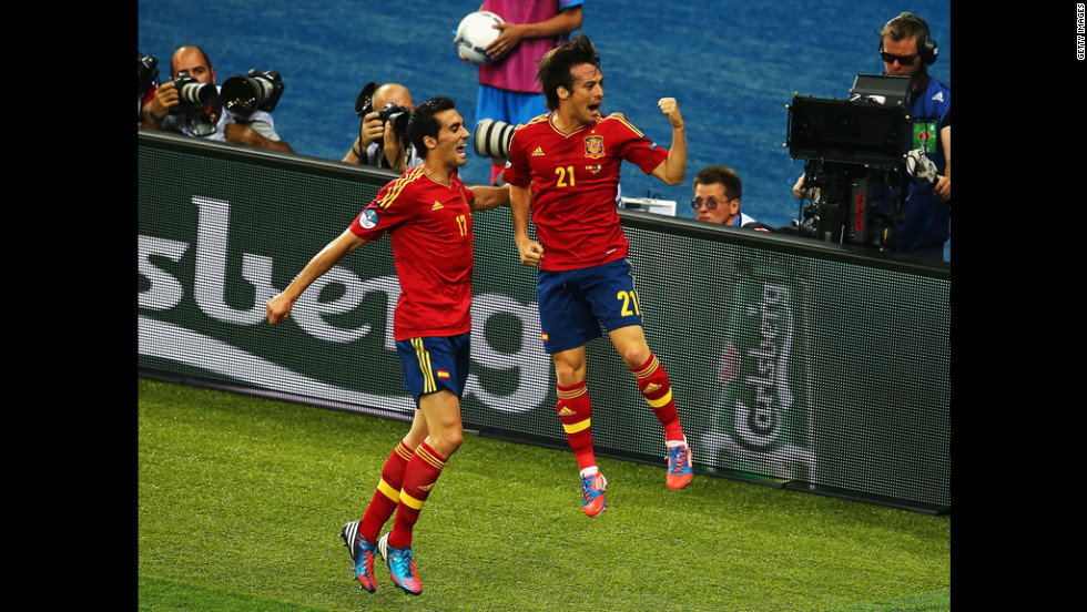 David Silva of Spain, right, celebrates with teammate Alvaro Arbeloa after scoring the opening goal against Italy.