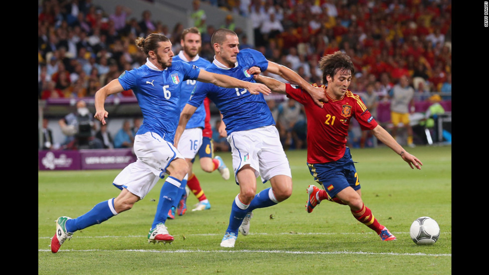 Federico Balzaretti, left, and  Leonardo Bonucci of Italy challenge Spain's David Silva during Sunday's final match.