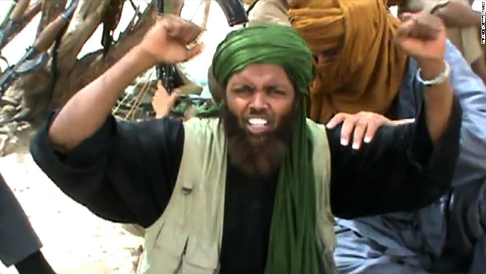 "An Islamist militant celebrates and shouts ""Allahu Akbar"" (God is Greatest) after destroying an ancient shrine in Timbuktu."
