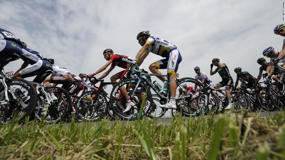 The peloton races through the Belgian countryside Monday.