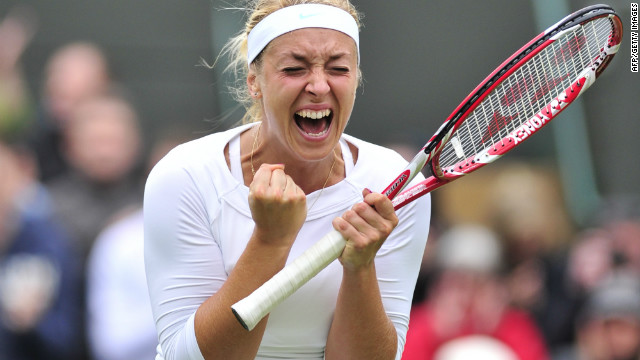 Germany's Sabine Lisicki celebrates her fourth round women's singles victory over Russia's Maria Sharapova on day seven of the 2012 Wimbledon Championships tennis tournament at the All England Tennis Club in Wimbledon, southwest London, on July 2, 2012. AFP