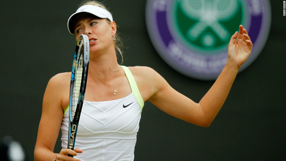 World No. 1 Maria Sharapova shows her disappointment after losing to Sabine Lisicki in the fourth round at Wimbledon, ending the Russian's hopes of repeating her 2004 success.