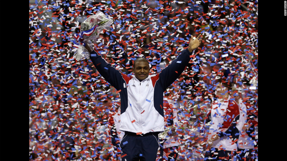 John Orozco celebrates in the confetti after being named to the U.S. Gymnastic team that will go to the 2012 London Olympics.