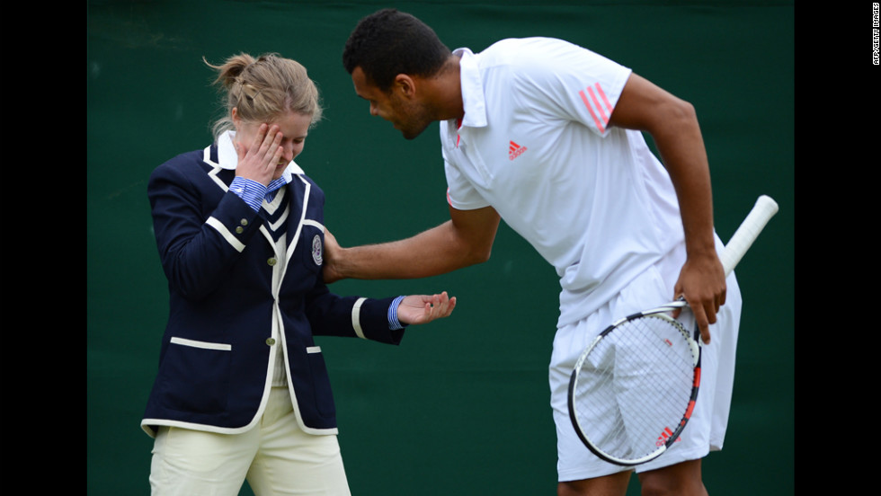 France's Jo-Wilfried Tsonga attends to a line judge who was hit in the face Monday by a ball during his fourth-round men's singles match against Mardy Fish of the U.S.