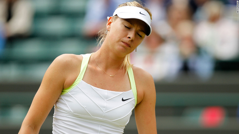 Top-seeded Maria Sharapova of Russia loses to Sabine Lisicki of Germany.