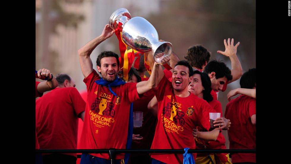 Juan Mata, left, and Santi Cazorla of Spain hoist the Euro 2012 trophy during Monday's celebrations.