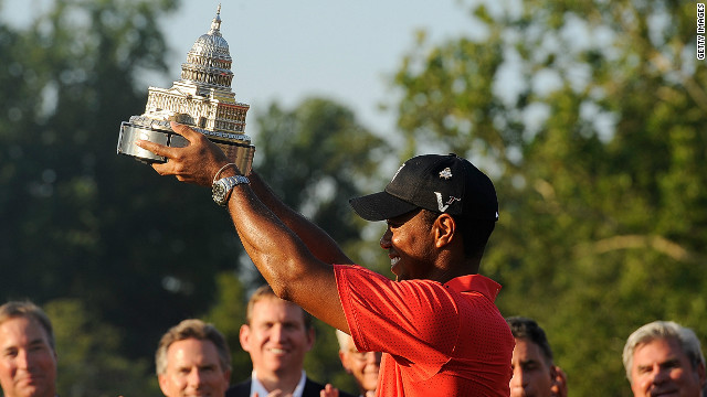 Tiger Woods lifts the AT&T National trophy after his two-shot victory at Congressional.