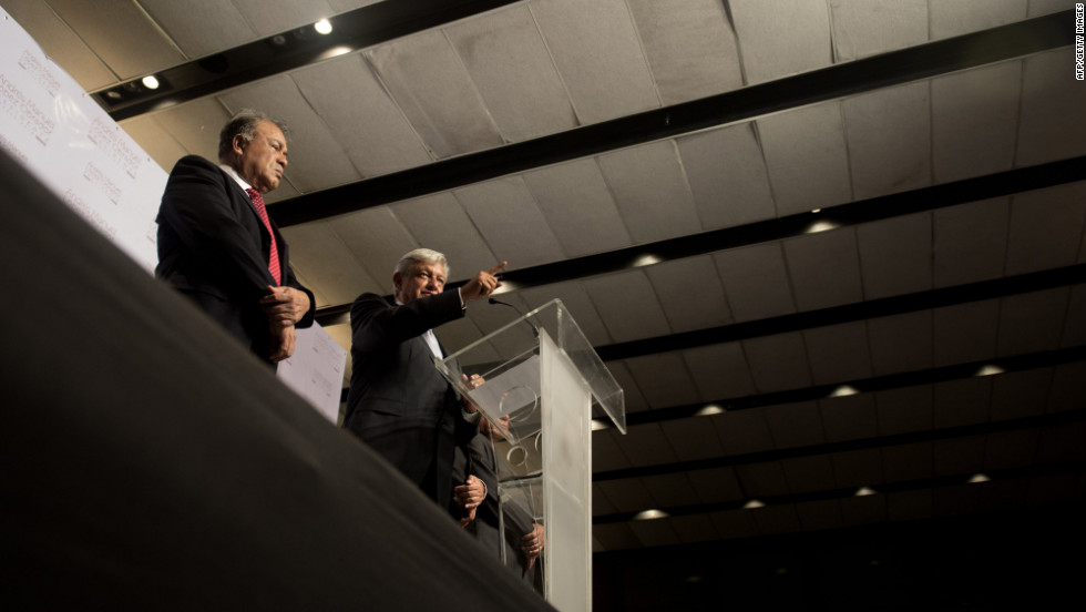 Projected as the runner-up in Sunday's vote, Andres Manuel Lopez Obrado, right, speaks in Mexico City on Monday. He said he was awaiting the official election results and prepared to contest them before judicial authorities if they didn't turn out in his favor.