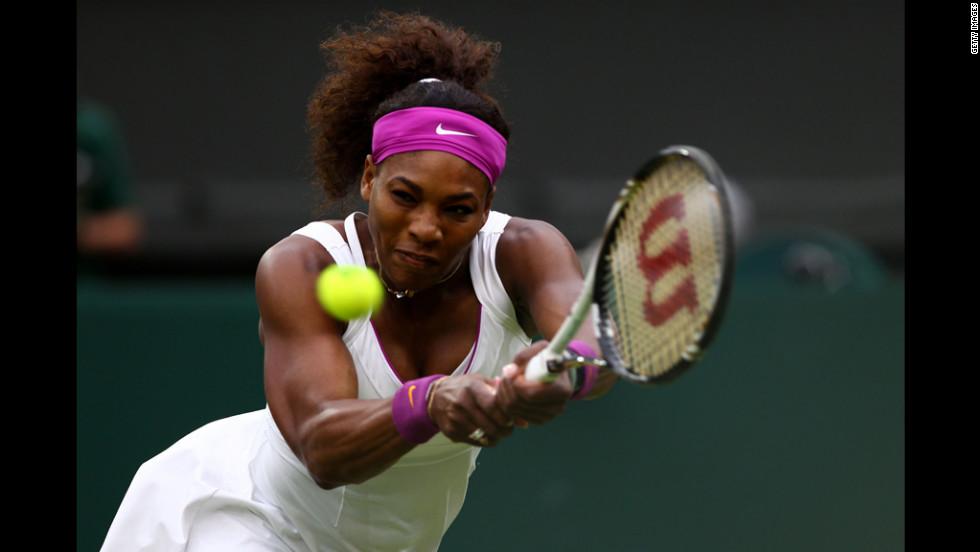 American Serena Williams returns a shot during her Ladies' Singles quarterfinal match against Petra Kvitova of the Czech Republic.