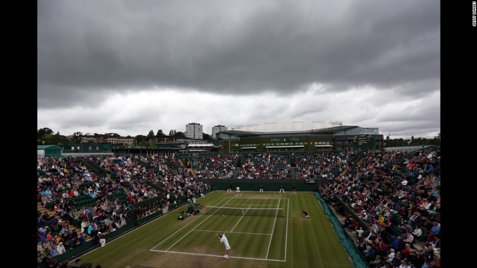 Tsonga of France plays American Mardy Fish on Day Eight of Wimbledon.