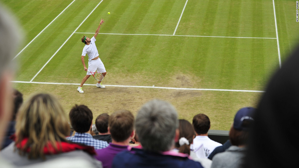 Mardy Fish of the United States serves to France's Jo-Wilfried Tsonga on Tuesday.