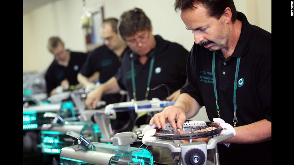 Workers re-string rackets for players at Wimbledon on Tuesday.