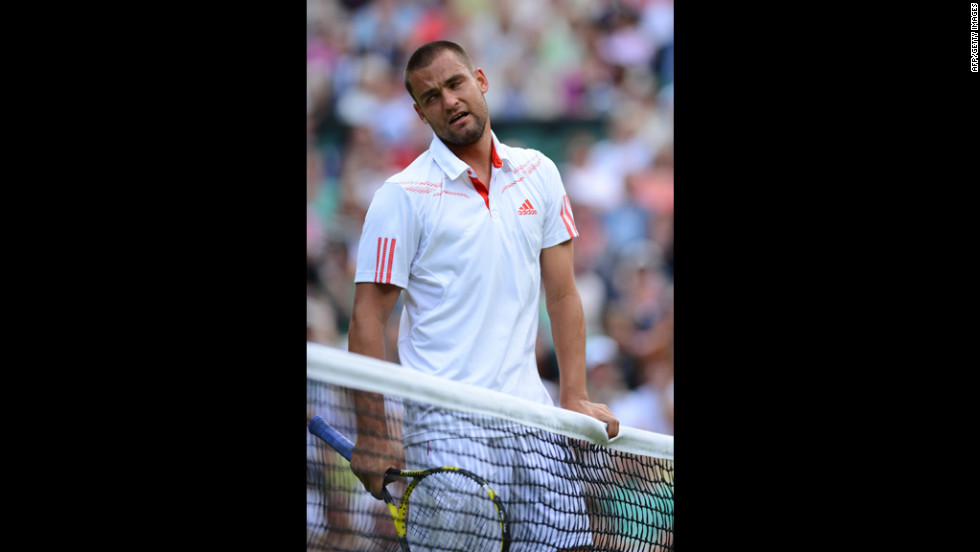 Russia's Mikhail Youzhny reacts during his men's singles quarterfinal match against Switzerland's Roger Federer on Wednesday.