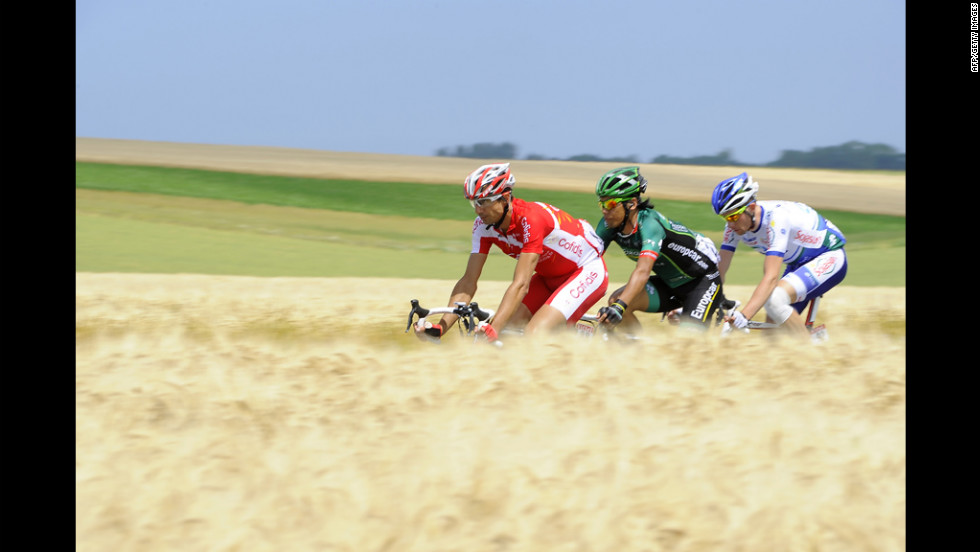 France's David Moncoutie, Japan's Yukiya Arashiro, and France's Anthony Delaplace ride in a breakaway.