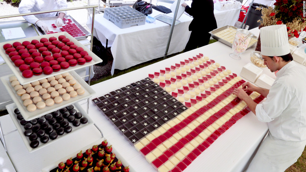 "Chefs prepare ""Stars and Stripes"" desserts for a buffet at the U.S. Embassy in Paris on Wednesday."