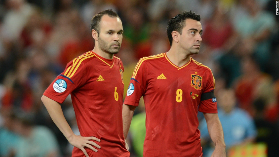 Spain's midfield pairing of Andres Iniesta (left) and Xavi (right) have epitomised the team's passing-based style. The Barcelona pair have been much-heralded throughout Spain's recent triumphs, with Iniesta being named the best player at Euro 2012.