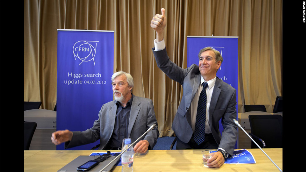 Joe Incandela, right, spokesman for the Compact Muon Solenoid experiment, gestures to the crowd next to Rolf Heuer, director-general of the European Organization for Nuclear Research, CERN, at a press conference announcing the major breakthrough in July 2012 in Meyrin, Switzerland.