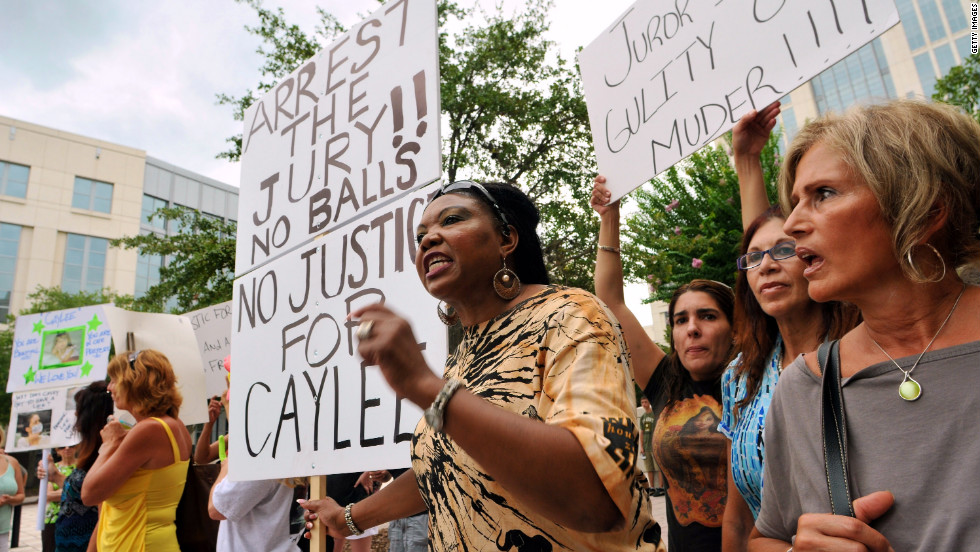 The not-guilty charge divided many people who followed the case. Flora Reece, center, of Orlando protests the verdict outside the Orange County Courthouse on July 7, 2011.