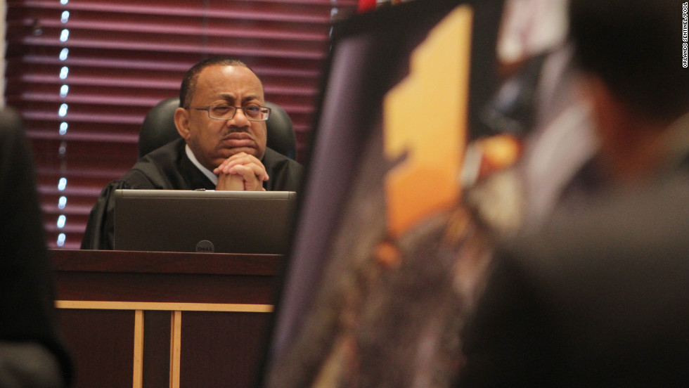 Judge Belvin Perry looks at evidence as it's presented during the trial last summer.
